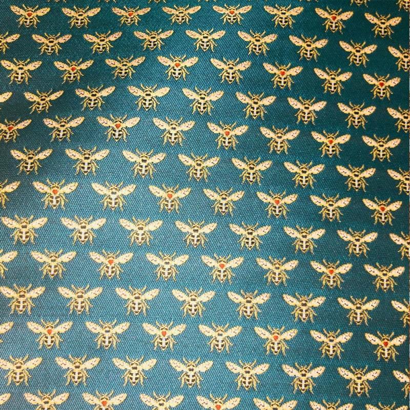 Tissus Jacquard HONEY brodé d'abeilles dorées sur un fond Vert Émeraude.