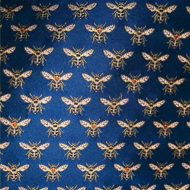 Tissus Jacquard HONEY brodé d'abeilles dorées sur un fond bleu paon.