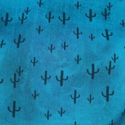 Tissu Viscose imprimée de cactus noirs sur un fond Bleu.