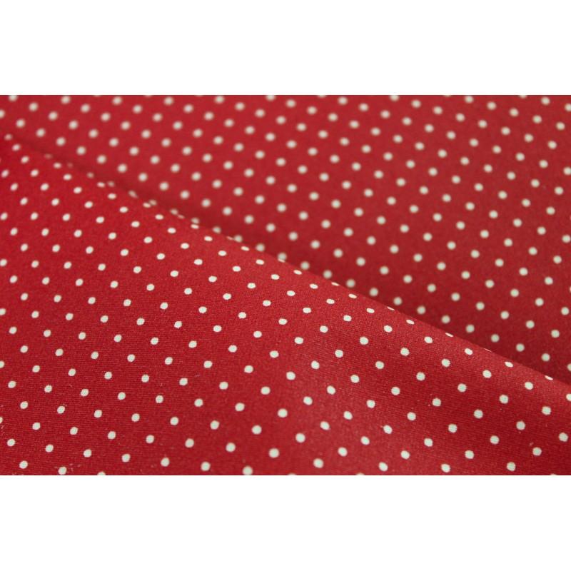 Coton enduit à pois rouge